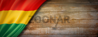 Bolivian flag on vintage wood wall banner