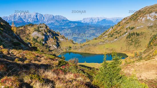Autumn alpine Grosser Paarsee or Paarseen lake, Land Salzburg, Austria. Alps Hochkonig rocky mountain group view in far.
