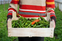 Woman holding a box of hot peppers