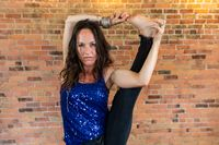 Serious woman with stern face does yoga