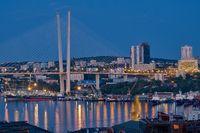 Vladivostok, Russia - Jun 11, 2020: Night view of the city of Vladivostok. Golden bridge in Vladivostok at night.