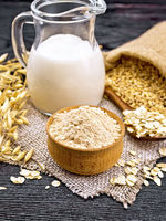 Flour oat in bowl on wooden board