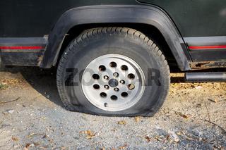 Flat tire of a car