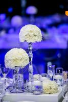 Decor with candles and white flowers for a large corporate party event or Gala Dinner