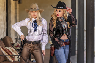 Two Lovely Blonde Models Dressed As Cowgirls Enjoys The American West