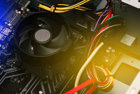 Details of a laptop computer. Computer circuit board and processor cooling fans. PC service and repair concept.