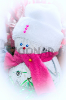 snowman from white sock in hat and pink scarf