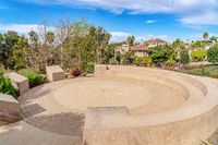 Circular stone patio with built in bench in Huntington Beach CA neighborhood