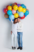 Couple with many color balloons