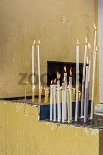Burning Candles Outside A Church Corfu Greece