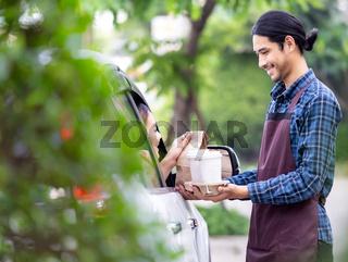 Waiter deliver food throght drive thru service
