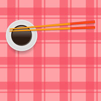 Soy Sauce and Traditional Colored Asian Chopsticks for Food on Red Square Background