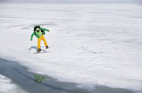 Snowboarding man outdoors in icy and snowy landscape