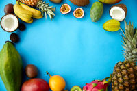 different exotic fruits on blue background