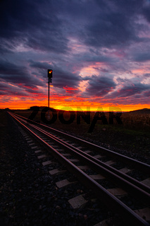 Morning train to the hell. Single railway track at sunrise