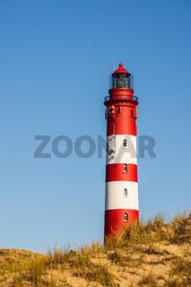 Leuchturm Amrum vor blauem Himmel auf der nordfriesischen Insel Amrum, Wittdün, Deutschland