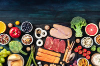 Food. Proteins like meat and fuish, fruit and vegetables, cheeese, rice, legumes, shot from above with copy space