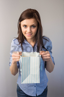 Cheerful pretty brunette receiving a present