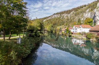 Idyllic view at the village Markt Essing in Bavaria, Germany with the Altmuehl river and high rocks