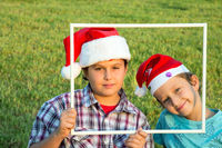Two brothers in joke caps Santa Claus