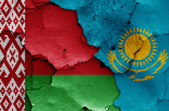 flags of Belarus and Kazakhstan painted on cracked wall