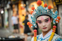 Chinese person in folk costume in Ci Qi Kou Ancient town in Chongqing