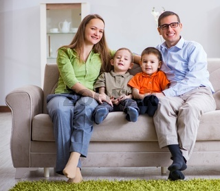 Young family playing in the room at home