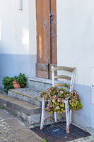 Wooden chair with flowers on Sardinia