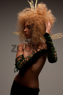 woman in crown with fashionable hair