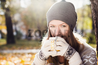 Young pretty woman with cup of tea