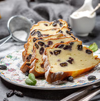 Slices of cottage cheese casserole with semolina and raisins.