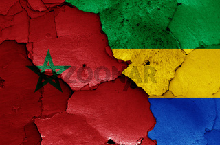 flags of Morocco and Gabon painted on cracked wall