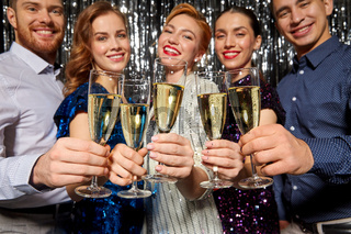 friends with champagne glasses at christmas party