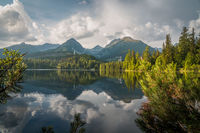 Mountain lake in National Park High Tatras. Strbske pleso, Slovakia, Europe. Late summer evening at lakeside.