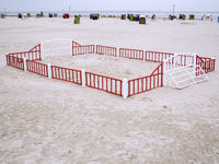 Fenced-in beach ball court copy space
