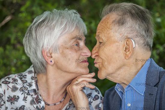 Kissing retired couple