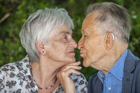 Kissing retired couple