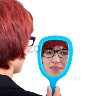 Woman looking in the hand mirror