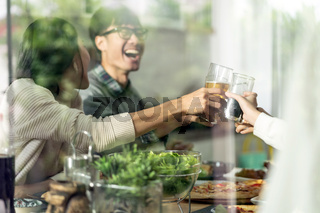 Happy asian multigenerational family cheers together