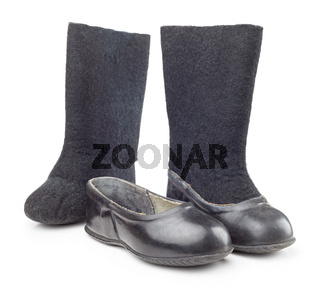 A pair of black rubber and felt boots and puffs  for children