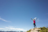 mountain climbing woman stretch and feel free