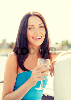 laughing girl with champagne glass