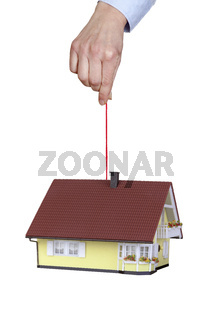 Hand holding house on the cord