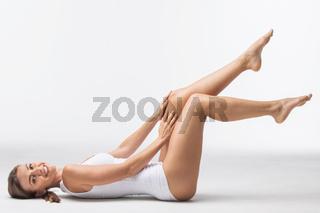 Woman lying in white underwear