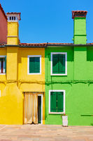 Houses with chineys in Burano island in Venice