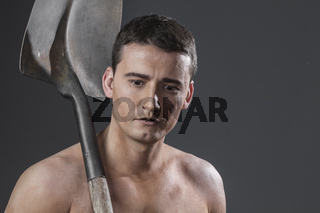 Builder.Male worker holding a shovel, sexy builder