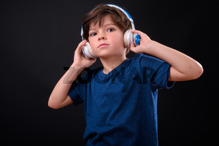 Portrait of young handsome boy listening to music