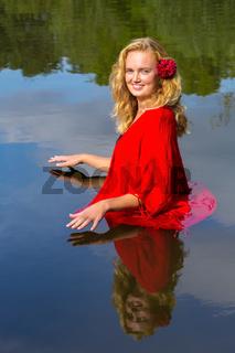 Portrait blonde caucasian woman stands in water