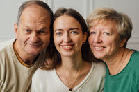Close up portrait of family with elderly mature woman, man and millennial daughter