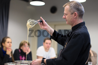 Belarus, Minsk, March 21, 2017. Culinary school. An open lesson on French cooking.Master class on cooking. The cook teaches you how to cook the dough